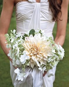 Susan's bouquet fit right in with the rural Massachusetts setting, with its stunning dinner-plate dahlia accented with hydrangeas and rosemary.