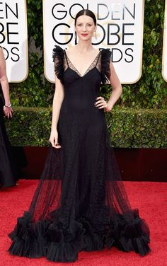 Outlander's Caitriona Balfe vamped it up in a black, semisheer Alexander McQueen dress, accessorized with Fred Leighton jewelry, a Christian Louboutin handbag and Roger Vivier shoes. See more of the Golden Globes' best dressed stars here!