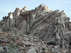 Anticline: a fold that is convex up and has its oldest beds at its core; usually recognized by a sequence of rock layers that are progressively older toward the center of the fold because the uplifted core of the fold is preferentially eroded to a deeper stratigraphic level relatively to the lower flanks