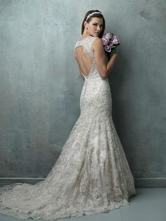 Allure Couture C326 | A glimmer of crystal beading is infused into this V-neck mermaid gown, which features a gorgeous open back.