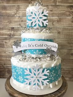 Winter Baby Shower Centerpiece, Baby It's Cold Outside Diaoer Cake, Snowflake Baby Shower Decorations by AllDiaperCakes on Etsy https://www.etsy.com/listing/573163051/winter-baby-shower-centerpiece-baby-its
