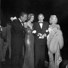 Lauren Bacall and Marilyn Monroe at the 1953 premiere of How to Marry a Millionaire.