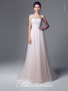 Simple, gorgeous, blush wedding gown with stunning tulle skirt.