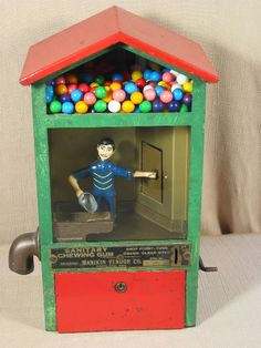 "Manikin Vendor. Manikin Vendor Co., Portland, OR, c. 1929, 16"".  Character inside scoops gumballs. Vending machine. Small Vintage Vending"