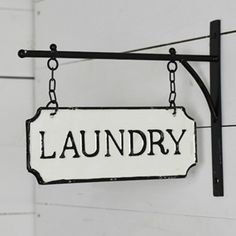 Tin Laundry Sign on Wall Mounted Bracket