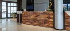 Finium Harvest Summit (Walnut) wall panels used on this reception frontage #wallpanels #woodwallpanels #officedeisgnideas #bardesignideas #moderndesign #hospitalitydesign