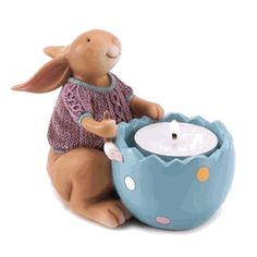 Snuggle Bunny Tealight Holder from Koehlerhomedecor.com - Snuggled in his cozy sweater, this smiling bunny readies his egg for an Easter extravaganza! A charming little statuette that perfectly holds a tiny tealight for a cheery springtime glow.  Buy wholesale at Koehler Home Décor.