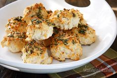 Easy Rosemary Garlic Parmesan Biscuits - The scent of Garlic + Rosemary + Baked Bread is absolutely intoxicating to me.