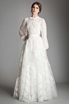 This fabulous Temperley wedding dress features a fabulous lace skirt and blouse.