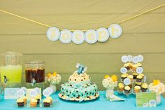 turquoise blue and yellow elegant elephant baby shower dessert buffet table with circle banner