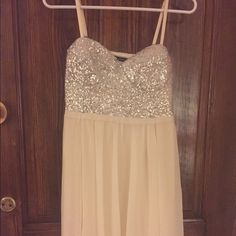 Boutique Ivory Chiffon & Silver Sequin Dress Purchased at a small boutique in Texas. Never been worn. A great little dress, flowy ivory chiffon with a silver sequin bodice and spaghetti straps. Gorgeous, but I've owned for a year and I've never worn it! Dresses Mini