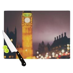 "Kess InHouse Laura Evans ""Westminster at Night"" Yellow color Cutting Board"