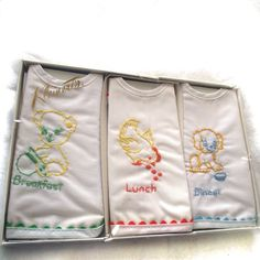 Vintage baby bibs, set of 3, hand embroidered, in original box. $8.00, via Etsy.
