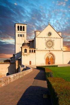 The upper facade of the Papal Basilica of St Francis of Assisi, ( Basilica Papale di San Francesco ) Assisi, Italy - begun in the 13th century