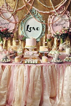 Beautiful! Vintage cake table at a pink themed weddng