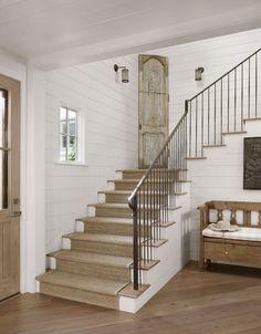 Wrought iron balustrade, sisal runner, horizontal planks