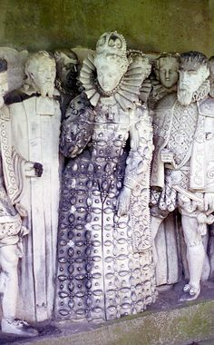 Queen Elizabeth I and leading figures from her court. From a carving in the gardens of Hatfield Place, 16th century