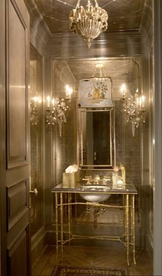 for formal powder room..LOVE THIS POWDER ROOM!!!!  love the dooor, love the antiqued diamond cut mirror on ceiling, love sconces, love antique mirror inside paneling on wall, ,love sink, love floor, love it all!!!  obsessed w/ this powder.., glamour, love love love-Jessica Lagrange Interiors.