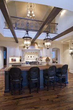 Schrader & Companies Traditional French Country.  Another example of upstairs exposed to kitchen??? Not sure about this