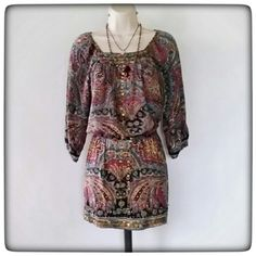 Paisley Print Dress BoHo cinched waist dress, embellished w/ brass color sequins around the neck, down the front,  and across the hem. Good condition .100% Rayon Angie Dresses Mini