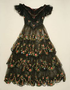 Sheer black silk evening dress with floral embroidery, probably British, 1856.