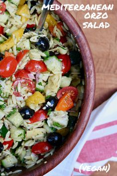 This Mediterranean Orzo Salad recipe Rocks! Fresh chopped veggies, perfectly cooked orzo pasta with the Best Greek Salad Dressing Ever! Tangy, slightly sweet, lemony, garlicky and full of herbs. Perfect easy summer salad for your next potluck or Bbq. Healthy and Vegan too!