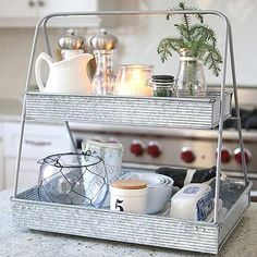 Think vertical! When it comes to clever countertop kitchen storage, tiered stands and trays provide both function and beauty. These seven ideas mix organization and decor so perfectly that it will become one organizing piece you'll want to leave out on the counter.