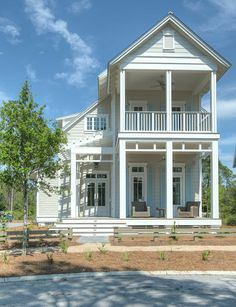 Beach House Design. Beach house with front porch and turquoise blue shutters…