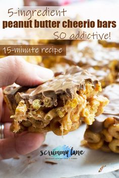 These addictive peanut butter Cheerio bars aren't just for kids. Perfect for parties or just keeping in the freezer for emergency treats. Just 5 ingredients and 15 minutes to make! #peanutbutter #Cheerios #chocolate #scrummylane #dessert #easydesserts