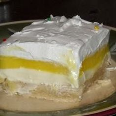 Lemon Lush - This really is such a great little recipe that is soo easy to make with such a nice combination of flavors-cream cheese,lemon and fresh whipped cream