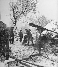 Soldiers dig foxholes in the frozen ground in the Battle of the Bulge.