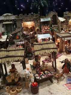 "Fontanini Christmas nativity display ideas. City market scene. Meat cutter, basket weaver, pottery shop. I've been a 5"" scale collector for 33 years, and have thousands of pieces. It's our family Christmas tradition."