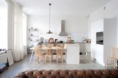 Chic: This Swedish kitchen has a classic Scandi style complete with industrial metal cabinets and simple wooden chairs.Located in Stockholm, Sweden, this eat-in kitchen is characterised by the pared-back Scandi style, clean lines, functional architecture and an emphasis on communal spaces (cost of project not available)