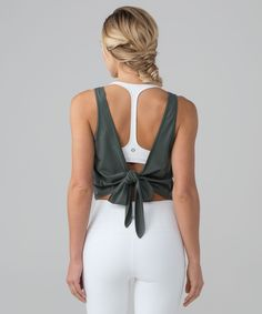 Choose your fit and look in  this tank. We designed it to  be worn two different ways:  tie a bow in the back to wear  loose or thread the tie  through the side seam slit to  tie the front for a  close-to-body fit.