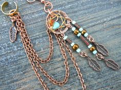 Hey, I found this really awesome Etsy listing at https://www.etsy.com/listing/165686204/one-copper-and-turquoise-dreamcatcher