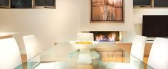 Caroline Serviced Apartments Brighton - Three bedroom platinum apartment dining table and fireplace