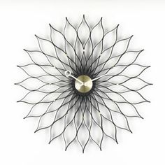 Sunflower Clock by Vitra. Gasp.
