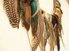 3. Hang your feathers on your wall in a fancy garland. | Make 33 Pretty Things With (Cruelty-Free) Feathers