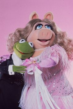 Miss Piggy doesn't need no man. While we have seen Miss Piggy marry Kermit several times in film, according to The Muppets Character Encyclopedia, all of their weddings have been fictional. She's a fly single lady. | 27 Reasons Miss Piggy Is The Ultimate Feminist Icon
