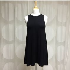 Black Swing Dress Black Sleeveless Swing Dress-96% Rayon, 4% Spandex. True to Size! One of my favorite dresses! Great for spring & summer! **Avail in Small, Medium, & Large. Please do not purchase this listing. Simply comment on what size you'd like & I'll create one for you** Dresses Strapless