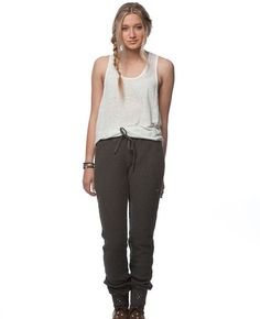 Chunky Loop Terry Studded Drawstring Lounge Pant by Gypsy 05 has a relaxed appeal, waffle-texture, ribbed banded ankles, studded detailing with a boho chic ambience. These sweats look great with a pullover tee, sweater, army boots or a pair of cute flats. Either way you will be styling,   COLOR: ASPHALT 100% Cotton  Made in Hollywood, CA. USA  Ribbed band ankles  Drawstring  Wash gentle cycle with like colors, hang to dry