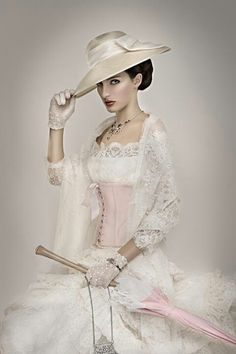 Steampunk wedding dress with pale pink corset and matching umbrella..