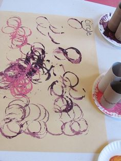 Painting with circles in preschool-did this last week.  Also gave them q-tips to paint with to add to the artwork.