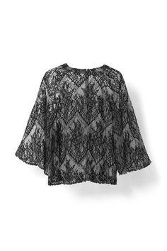 Bluse med blondedetaljer, oversize ærmer og rund  halsudskæring.