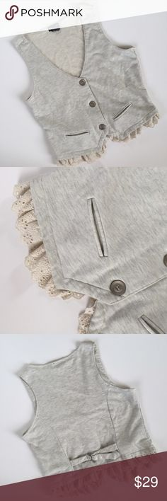 Eyelet Trim Vest Super cute vest! Light heathered grey color with cream eyelet trim. This is a juniors XL, fits like a medium in women's. Perfect for layering in fall with some boots! Great condition   No trades No ️aypal No Merc ✅Posh Rules ✅Use Offer Button ✅Bundle for 15% off  Wet Seal Tops Tank Tops