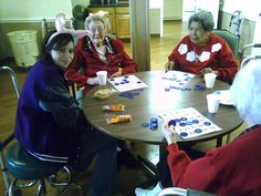 Amarillo Girl Scouts playing Bingo at local assisted living home.