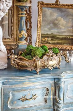 Jardiniere and old paintings on the dresser.