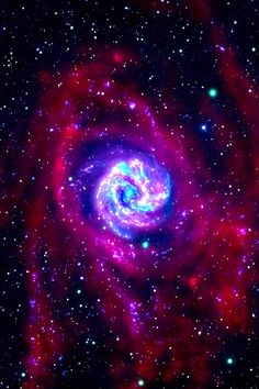 The outlying regions around the Southern Pinwheel galaxy, or M83, are highlighted in this composite image from NASA's Galaxy Evolution Explorer and the National Science Foundation's Very Large Array in New Mexico. The blue and pink pinwheel in the center is the galaxy's main stellar disk, while the flapping, ribbon-like structures are its extended arms.