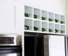 Wine Rack Storage Ideas Replace an enclosed cabinet above the refrigerator with a wine rack.