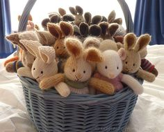basket of knitted bunnies - @K D Eustaquio Fetrow, thought of you and your baby photoshoots when I saw these.